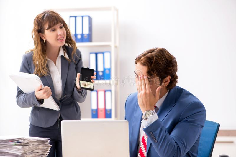The deaf employee using hearing aid talking to boss stock image