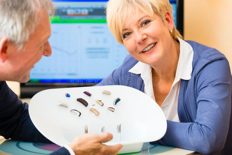 Deaf people taking a hearing test. Older men and women or pensioners with a hearing problem make a hearing test and may need a hearing aid royalty free stock photography