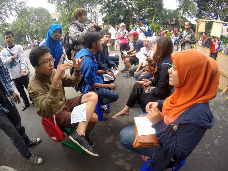 Deaf sign language. Is being taught to the people in a public space in the city of Solo, Central Java, Indonesia stock photo