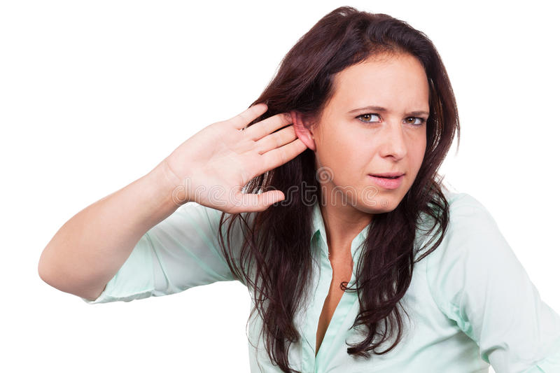 Deaf Woman. Holds her ear stock photography