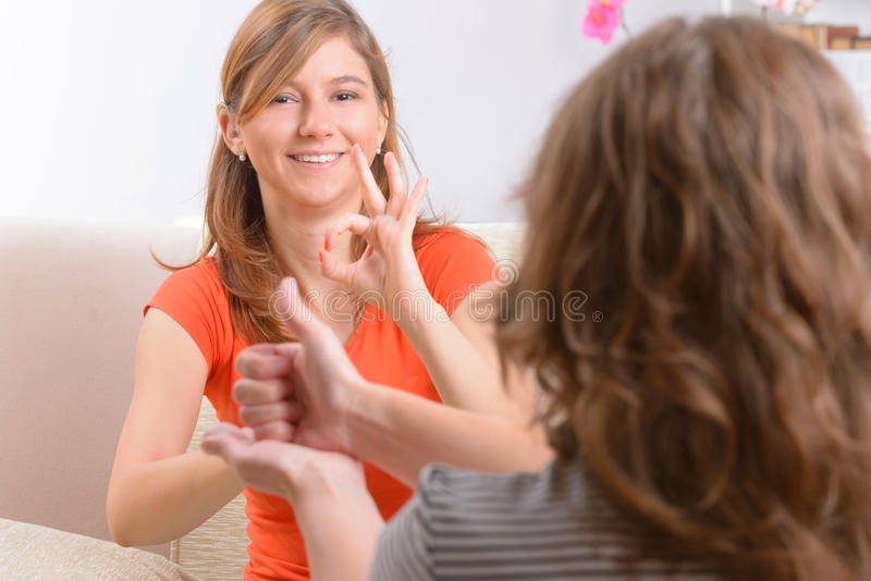 Deaf woman learning sign language royalty free stock image