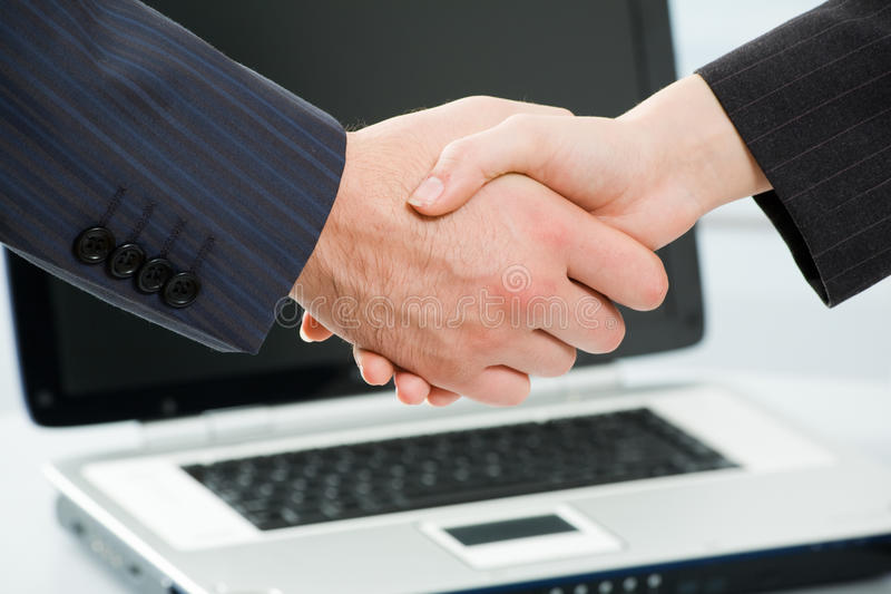 Deal. Business people joining hands together for deal royalty free stock photos
