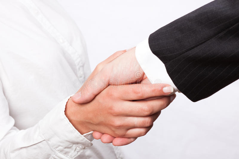 Deal. Man and woman shaking their hands in a greeting act stock photography