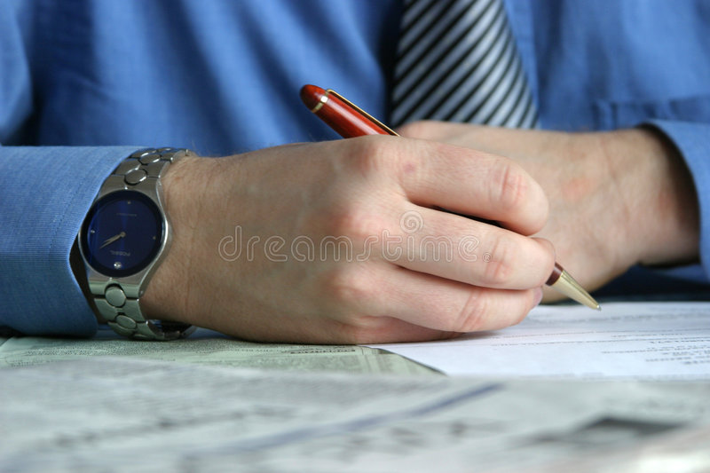 Deal - hand signing contract stock photography