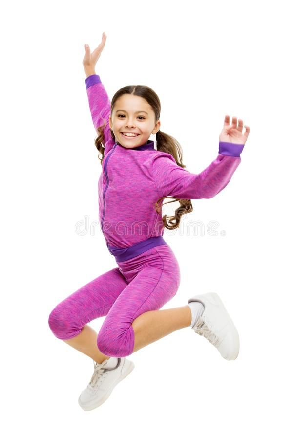 Deal with long hair while exercising. Girl cute kid with long ponytails sportive costume jump isolated on white. Working. Out with long hair. Sport for girls stock images