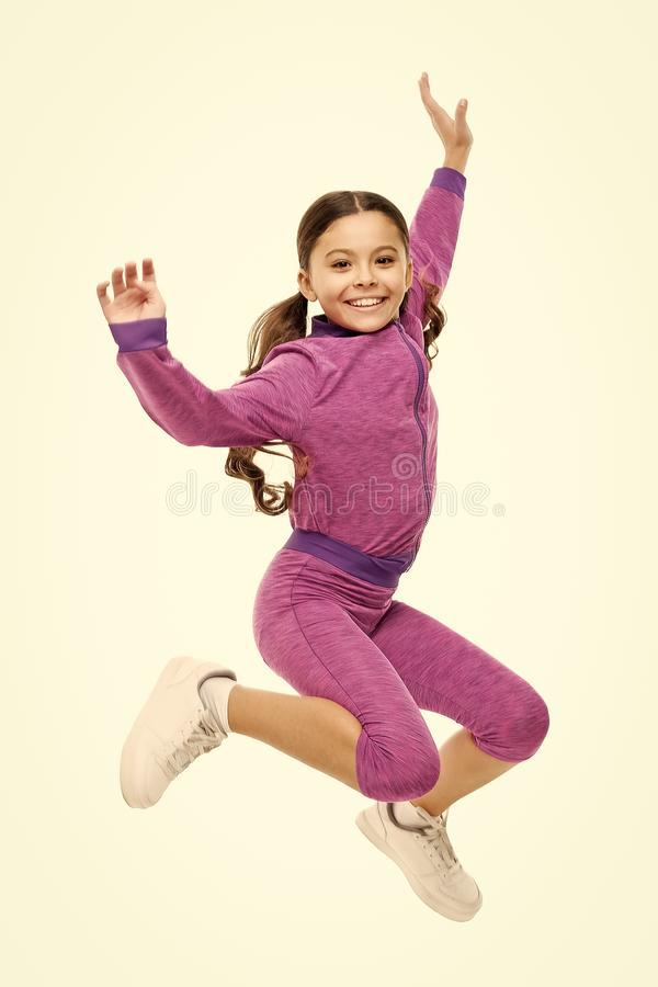 Deal with long hair while exercising. Girl cute kid with long ponytails sportive costume jump isolated on white. Working stock images