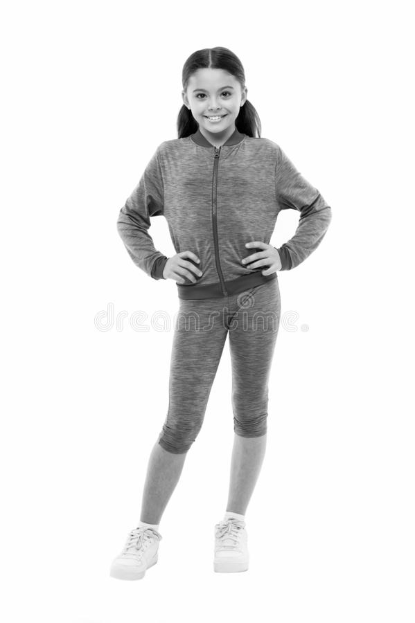 Deal with long hair while exercising. Girl cute kid with long ponytails wear sportive costume isolated on white. Working. Out with long hair. Sport for girls royalty free stock photos