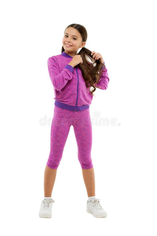 Deal with long hair while exercising. Working out with long hair. Girl cute kid with long ponytails wear sportive. Costume isolated on white. Sport for girls royalty free stock photo