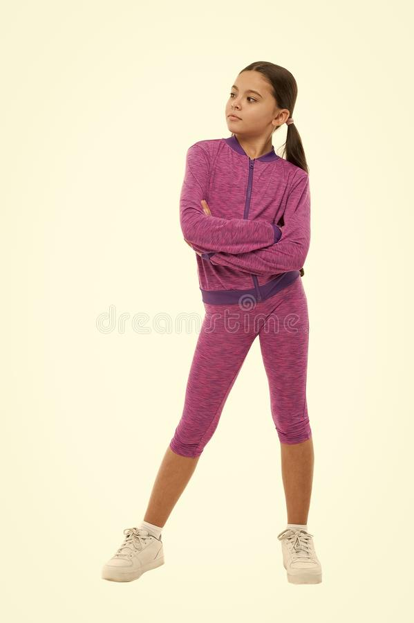 Deal with long hair while sport exercising. Working out with long hair. Girl cute kid with ponytails wear sport costume stock photos