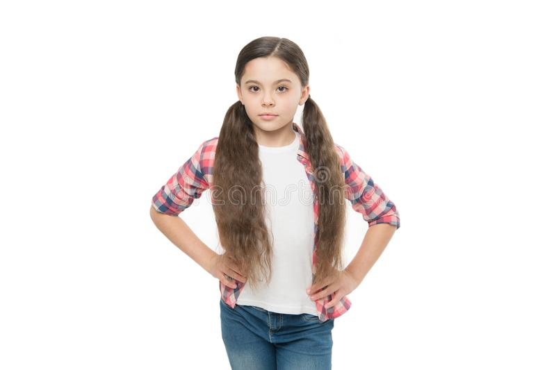 Deal with tangled hair. Girl cute kid with ponytails isolated on white. Conditioner oil or nourishing mask before. Brushing. How to comb long hair. Tangled hair royalty free stock photos