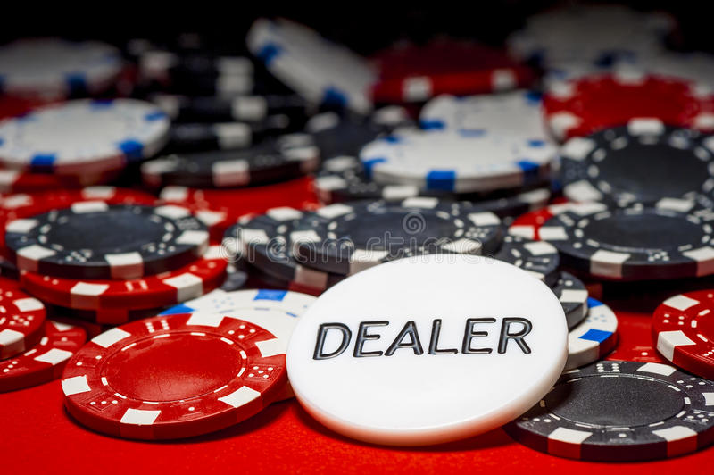 Dealer button and chips. For poker royalty free stock photography