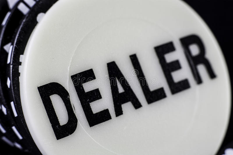 Dealer button. Row of gambling chips headed by dealer button royalty free stock image