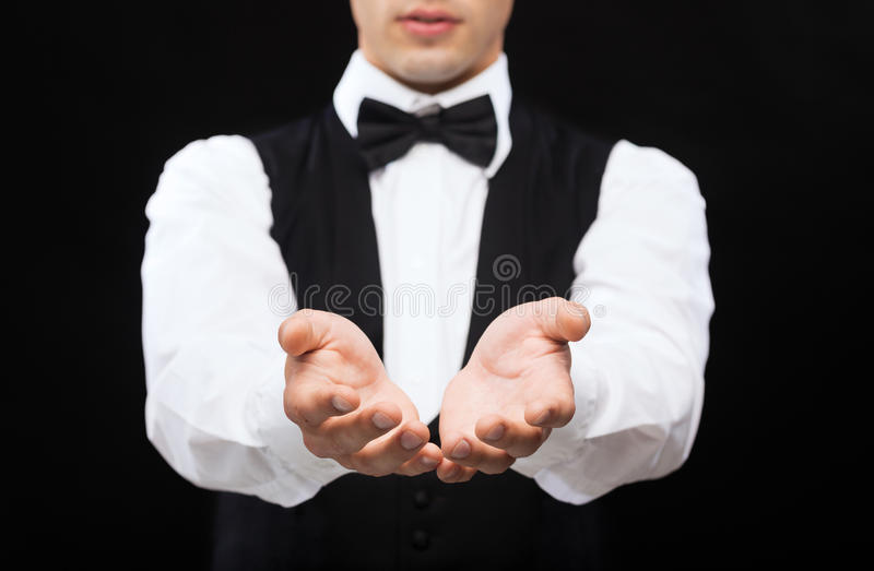 Dealer holding something on palms of his hands stock image