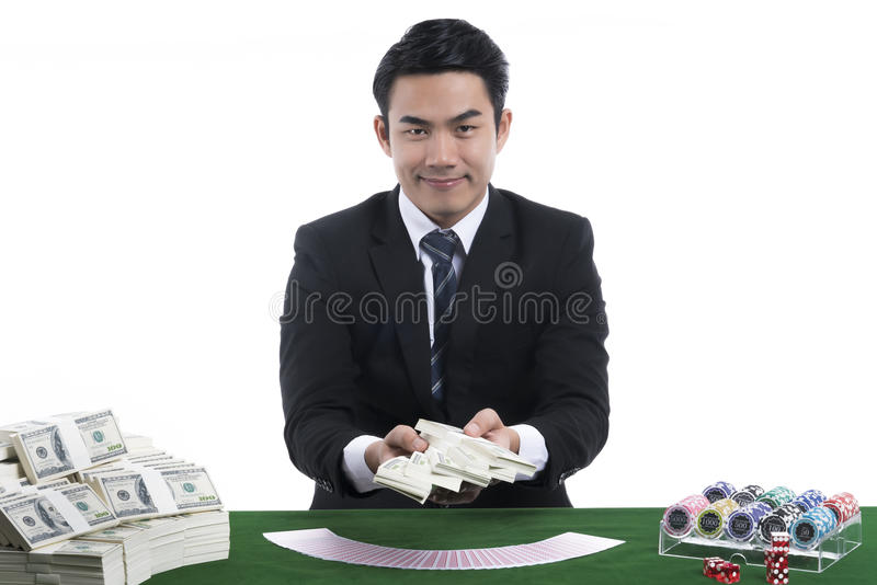 The dealer presenting banknotes in hand from gambling royalty free stock image