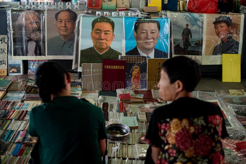Dealers selling their antique books and famous chinese people posters at  the Panjiayuan flea market in Beijing China stock photo