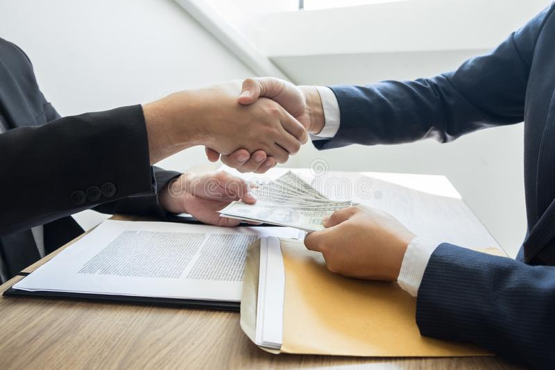Dealing greeting and partnership meeting concept, businessmen handshaking after finishing up deal contract for both companies royalty free stock photo