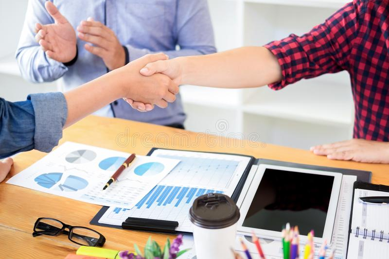 Dealing greeting and partnership meeting concept, businessmen handshaking after finishing up deal contract for both companies stock photography