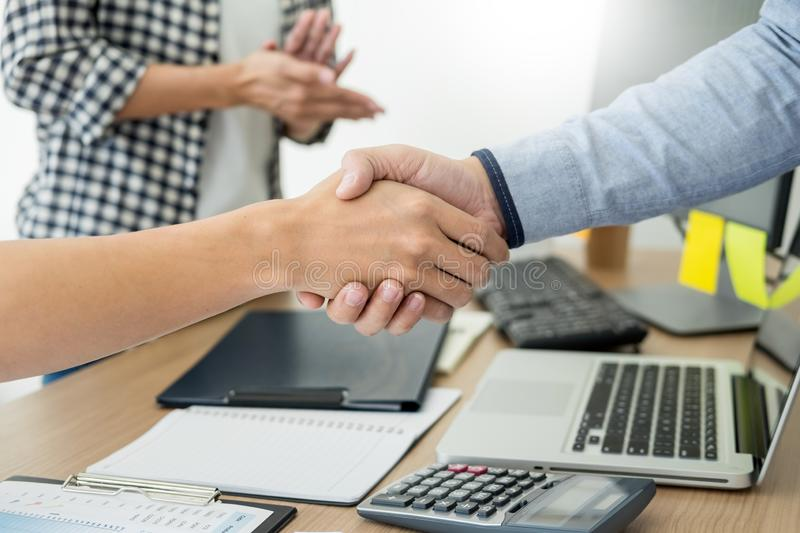 Dealing greeting and partnership meeting concept, businessmen handshaking after finishing up deal contract for both companies royalty free stock photos