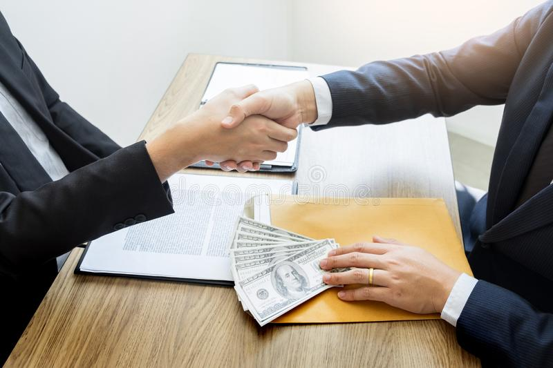 Dealing greeting and partnership meeting concept, businessmen handshaking after finishing up deal contract for both companies royalty free stock photography