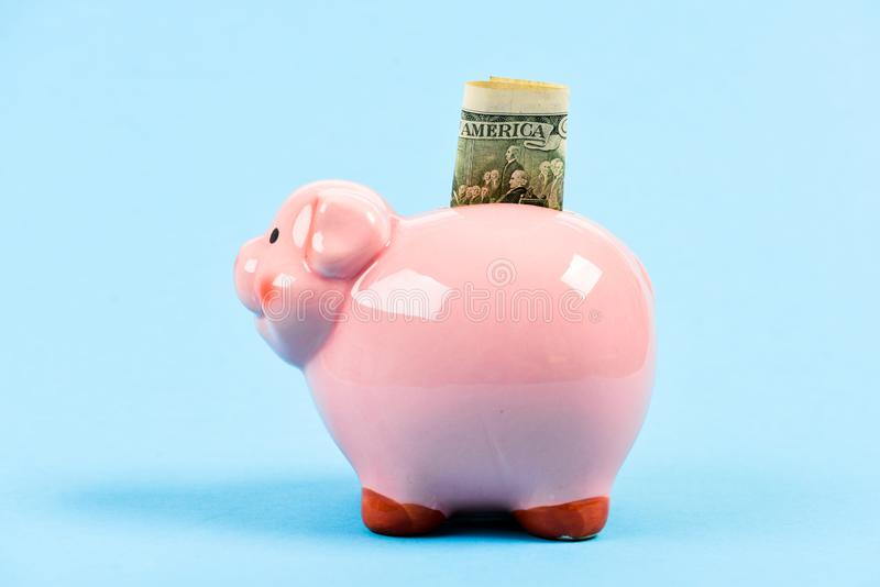 Dealing with money. finance and commerce. business startup. financial position. family budget. piggy bank with golden stock image