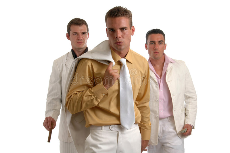 The Dealmakers. Three shady characters dressed in white and armed with money stock photos