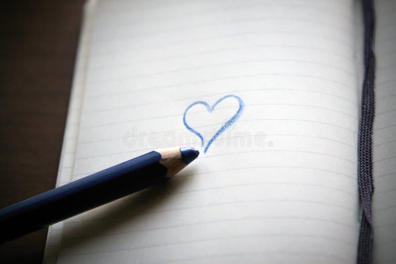 Dear Diary. Block notes on wood background. Moleskine stock image