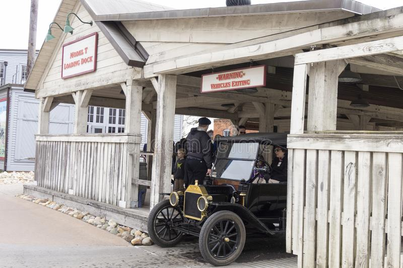 Dearborn, MI / USA - 04.21.2018 : Ford t model in the greenfield village coming out from the model t loading dock. Dearborn, MI USA - 04.21.2018 : Ford t model royalty free stock image