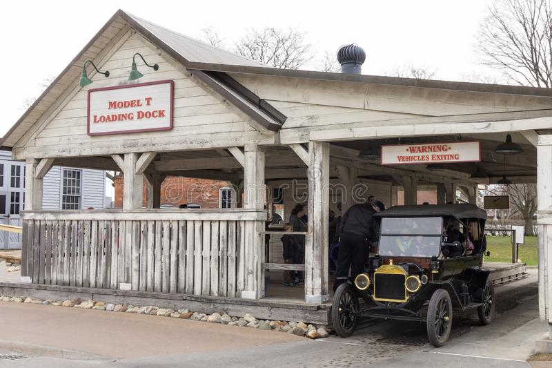 Dearborn, MI / USA - 04.21.2018 : Ford t model in the greenfield village coming out from the model t loading dock. Dearborn, MI USA - 04.21.2018 : Ford t model royalty free stock images
