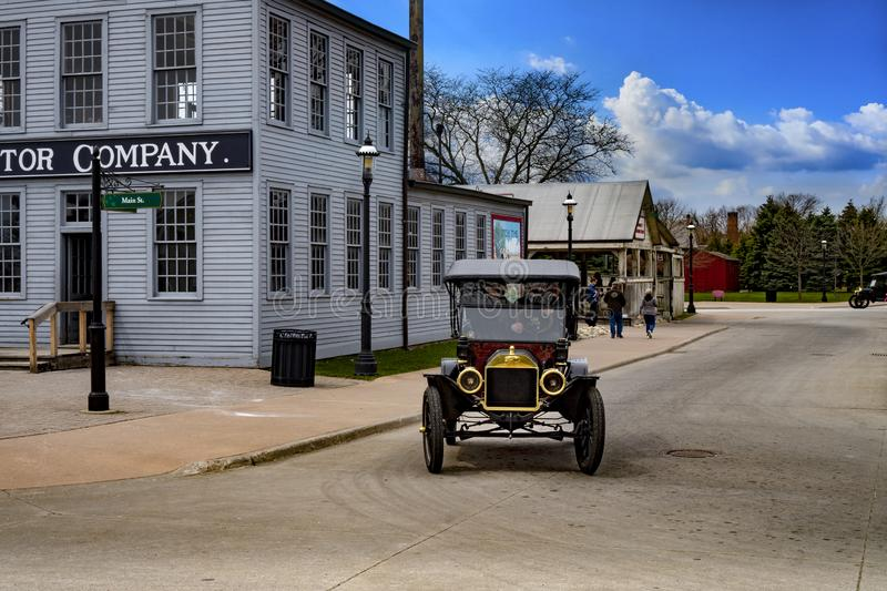 Dearborn, MI / USA - 04.21.2018 : Ford t model in the greenfield village next to the first old original rebuilt Ford Motor Company. Dearborn, MI USA - 04.21.2018 stock images