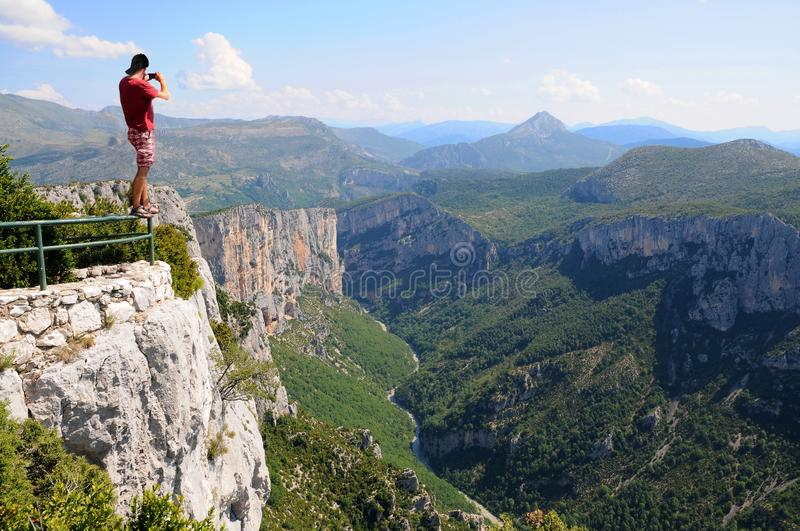 Dearing feat, man balances over the abyss. Man climbing on a balustrade just to take an extraordinary photo from the  of Georges Verdon stock images