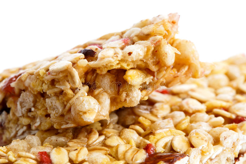 Deatail of one and half muesli bars on white. royalty free stock image