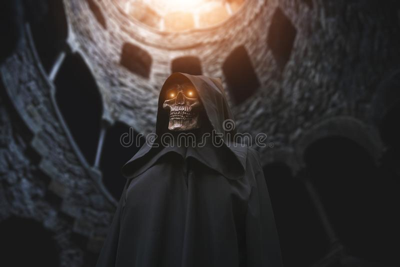 Death with burning eyes in abandoned castle stock image