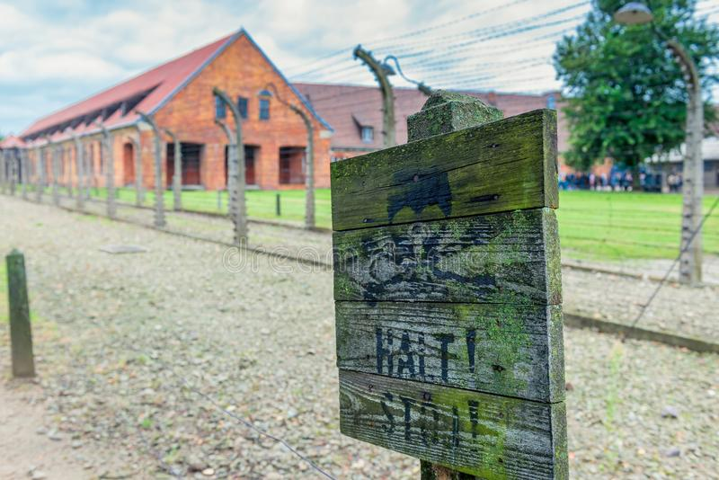 The death camp of Auschwitz Auschwitz 1940-1945. About 1.4 mil. Auschwitz, Poland - August 12, 2017: Auschwitz concentration camp close-up warning sign on the stock photography