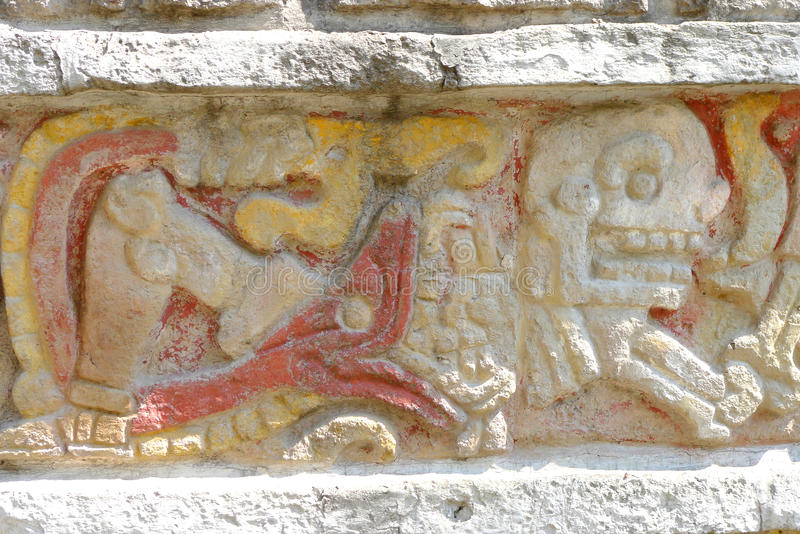 Death ceremony. This sculpture on outside wall of Anthropology Museum in Mexico City shows the human sacrifice practiced by Aztec civilization royalty free stock images