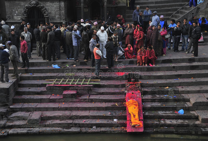Death ceremony at Pashupatinath Temple. Death ceremony for a normal cast at theat burning ghats in the Pashupatinath Temple Bagmati River in the eastern part of royalty free stock images