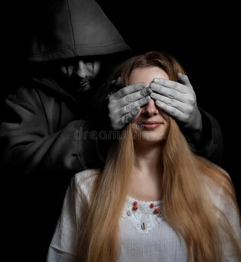 Death concept: woman surprised by evil man royalty free stock photography
