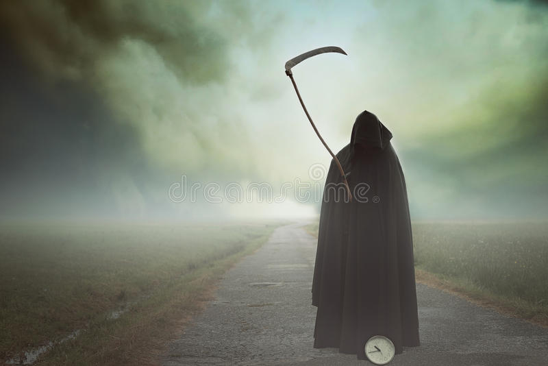 Death with scythe in a surreal landscape royalty free stock photography