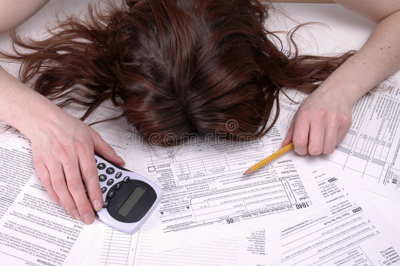 Death by Taxes. A woman slumped over in despair on a pile of tax forms
