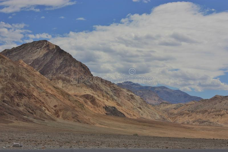 Death Valley Dreaming. This photo taken while traveling through Death Valley National Park in California is deceptive in its subtle colors belying the arid heat stock photo