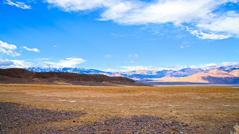 Death Valley National Park. Borax mule.  clouds and winding.  landscapes. clouds, rocks, desertfloor, winding, road royalty free stock images