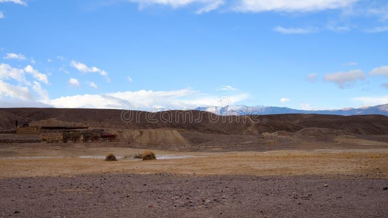 Death Valley National Park - mule wagon. Death Valley National Park borax mule. Death Valley National Park clouds and winding. Death valley national park stock image