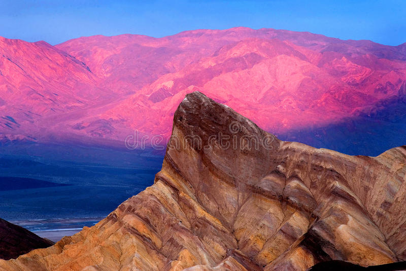 Bright pink mountains. Beautiful, bright pink sunrise photo in Death Valley, California royalty free stock photography