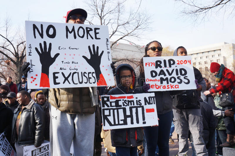 Deaths of Black People. Photo of protesters downtown at pennsylvania avenue in washington dc on 12/13/14. These people are displaying signs that tell about the royalty free stock photos