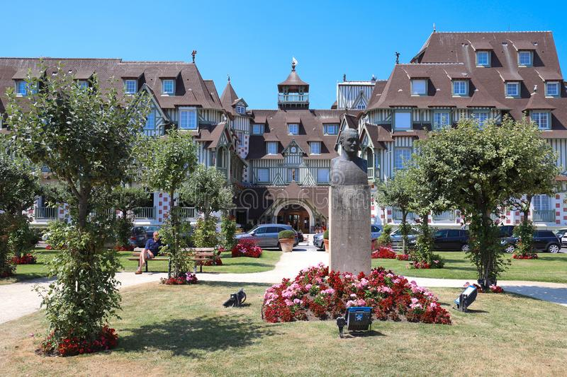 Famous five star hotel and park in the foreground - Le Normandy hotel. Deauville, Calvados department of Normandy. DEAUVILLE, FRANCE-July 14 ,2018: Famous five royalty free stock images