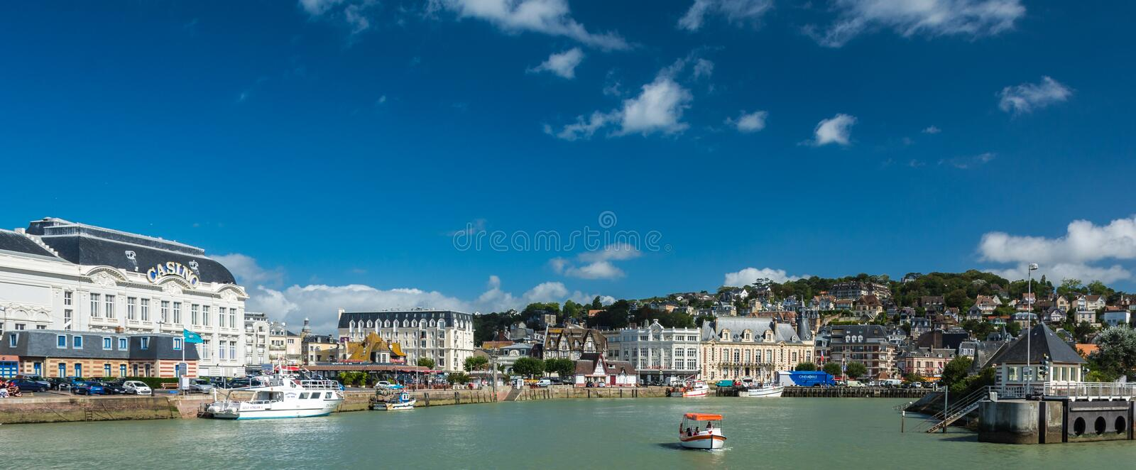 Deauville harbour. Deauville, France - September 8, 2016: With its harbour, film festival, marinas, Grand Casino and sumptuous hotels, Deauville is regarded as stock photo
