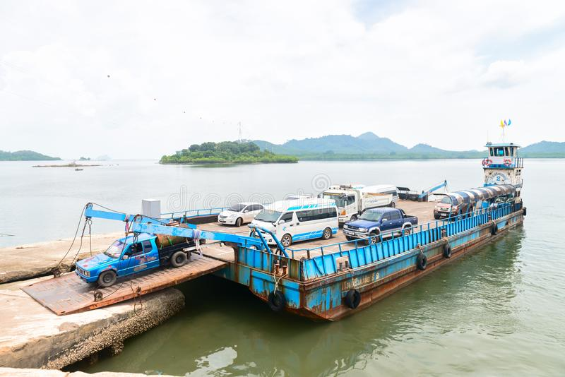 Debarkation of ferry boat vessel for passengers and cars in Thai. LANTA, KRABI, THAILAND - 17 OCT 2014: Debarkation of ferry boat vessel for passengers and cars royalty free stock image