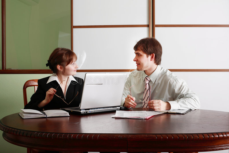 Debate. Group of business people working together in the office royalty free stock image