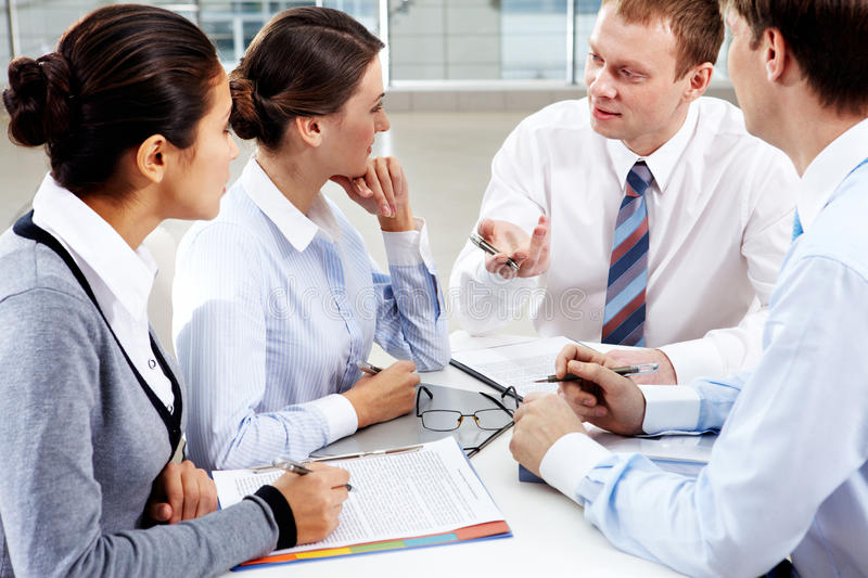 Debating. Image of confident colleagues listening to new ideas at meeting stock photo