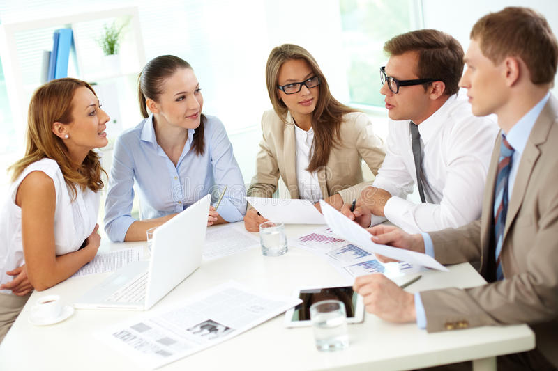 Debating. Image of confident partners sharing new ideas at meeting royalty free stock photo