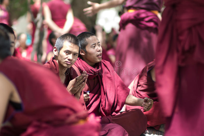 Debating Buddhist scriptures - Lamas at Tibet Sera Monastery. The Sera Monastery in Tibet and its counterpart in Mysore, India are noted for their Monk Debates royalty free stock photo